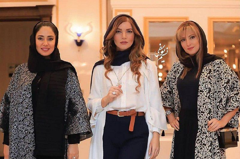 Matin Sotudeh (middle) was dressed in a hijab and buttoned-up, long-sleeved tunic that was tucked into belted pants at her October 10 red-carpet appearance in Tehran.